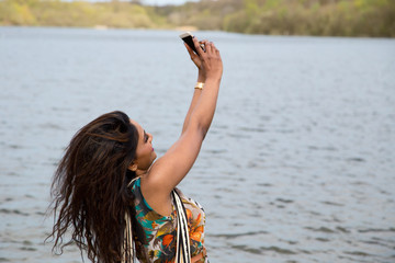young indian woman taking a selfie