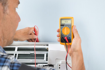 Technician Testing Air Conditioner
