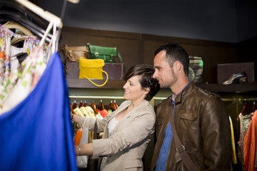 Couple at store shopping clothes
