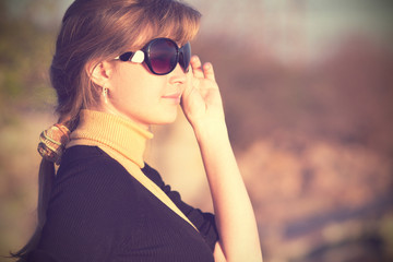 Vintage photo of a beautiful girl in sunglasses