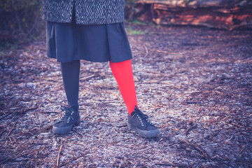 Woman wearing odd leggings on frosty ground