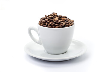 White coffee cup with saucer, and coffee-beans isolated on white