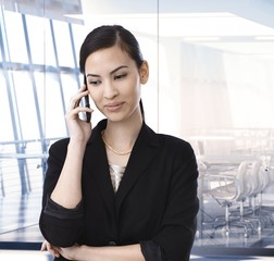 Executive asian businesswoman on the phone