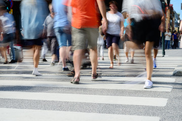 Diversified crowd on street