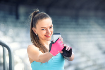Portrait of fitness woman taking selfie with phone camera.