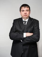 Fashion young businessman black suit  studio