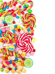 Fototapete - Colorful candies and lollipops isolated on a white background