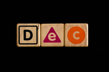December on wood Cubic on black background