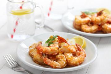 garlic shrimp, hawaiian food on white wooden background