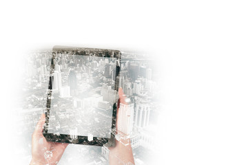 Double exposure of human hands with digital tablet and city