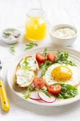 eggs with cherry tomatoes, radishes, arugula and cheese sandwich
