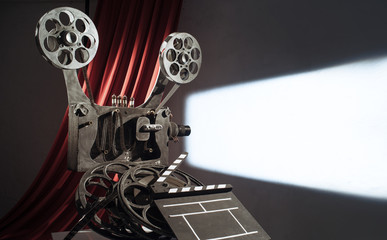 Film projector projecting a movie on the wall
