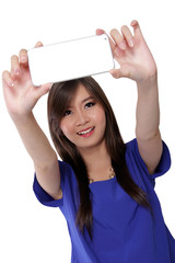 Cute Asian girl taking a selfie, isolated on white background