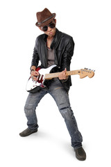 Rock guitarist strumming his guitar, isolated on white