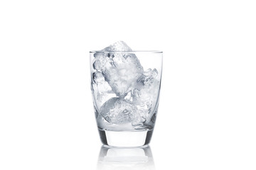 glass with ice cubes on white background