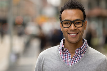 Young African Asian man in New York City smile face portrait