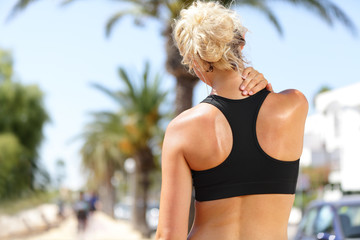 Neck pain - Sport runner woman with back injury