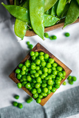 Peas on wooden background
