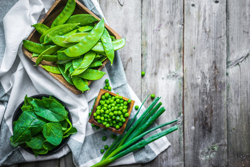 Green vegetables on wooden background