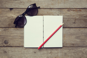 glasses , notebook and pencil in vintage style
