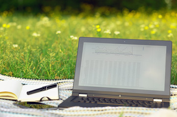 Outdoor office with laptop and notebook