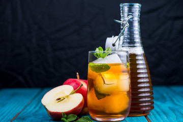 Glass of refreshing apple and mint juice with ice, drink backgro