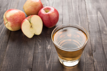 Healthy apple juice drink and red apples fruits on wooden backgr