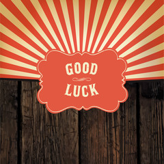 "Wild west styled ""Good Luck"" message on wooden board. With red r"