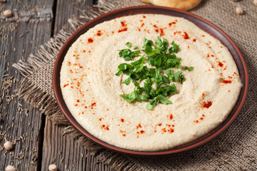 Creamy hummus hebrew chick-pea food in bowl with olive oil and