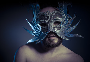Costume, bearded man with silver mask Venetian style. Mystery an