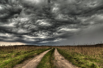 dirt road going into the eye of the storm.