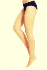 Woman legs in black panties