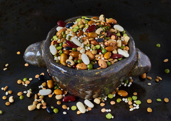Assorted legumes and cereals on dark background