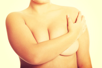 Overweight woman covering her breast