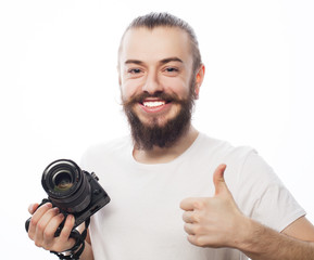young  photographer  with digital camera.