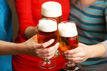 Beer in female hands, closeup
