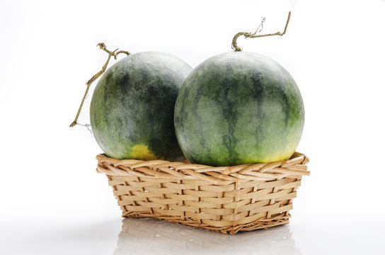 still-life photo of watermelons in a basket