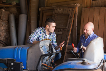 Two drivers working with tractor