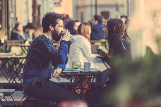 Hipster couple drinking coffee in Stockholm old town.
