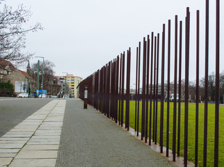 detail of steel poles of berlin wall