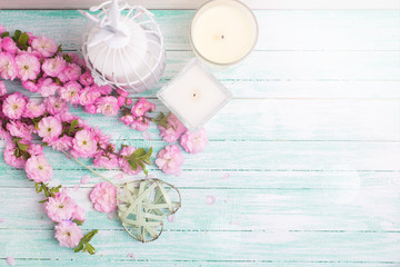Postcard  with fresh  pink flowers and candles