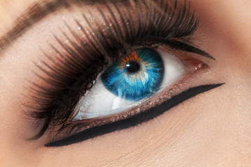 Macro photo of blue eye. Crying woman