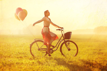 Woman on a Bike with balloons