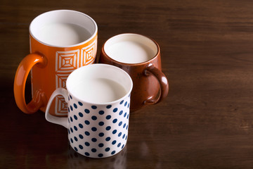 Three tea cups with milk
