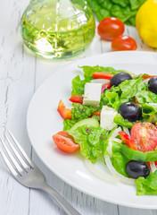 Greek salad on a white plate closeup
