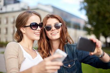 students or teenage girls with smarphone