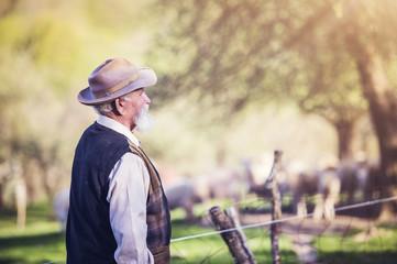 Senior farmer outside in beautiful summer nature