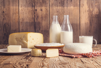 Foto op Textielframe Zuivelproducten Variety of dairy products laid on a wooden table background