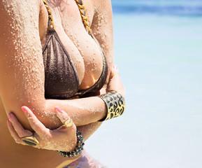 Woman with big breasts in bikini