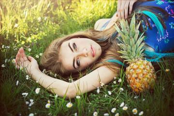 Beautiful boho woman lying in grass in summer